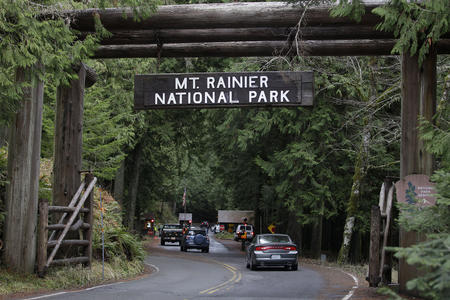 The west entrance to Mount Rainier National Park during busier times, before COVID-19 health concerns brought parks to a standstill. As Washington considers how to re-open the public lands social distancing will remain a priority. (Ted S. Warren/AP)