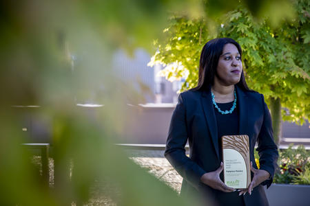 Patience Malaba holds the 2020 Bullitt Environmental Prize near her home in Seattle.