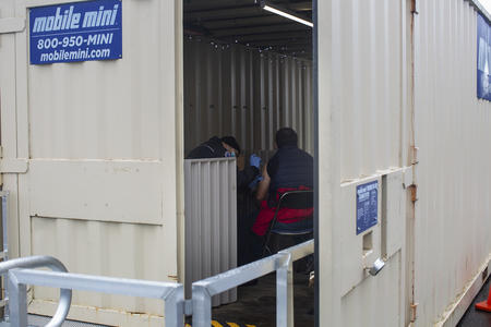 people inside trailer administering vaccines