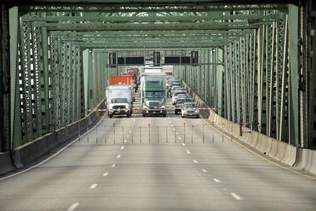 Trucks stopped on bridge