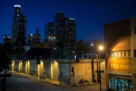 FILE - In this April 25, 2016, file photo, homeless people sleep in the Skid Row area of downtown Los Angeles. (AP Photo/Jae C. Hong, File)