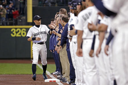 Seattle Mariners' Ichiro Suzuki, left, greets teammates as he is introduced before the team's opening day baseball game against the Cleveland Indians Thursday, March 29, 2018, in Seattle. (AP Photo/Elaine Thompson)