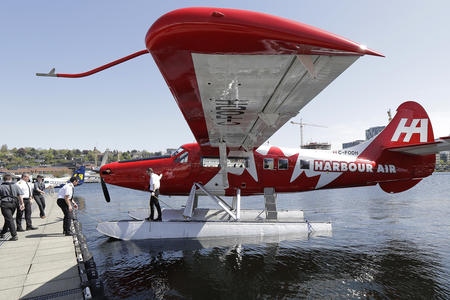 A Harbour Air seaplane is docked Wednesday, April 25, 2018, on Lake Union in Seattle. A partnership between Harbour Air and Kenmore Air will start offering direct one-hour seaplane flights between downtown Seattle and Vancouver, BC. (AP Photo/Ted S. Warren)