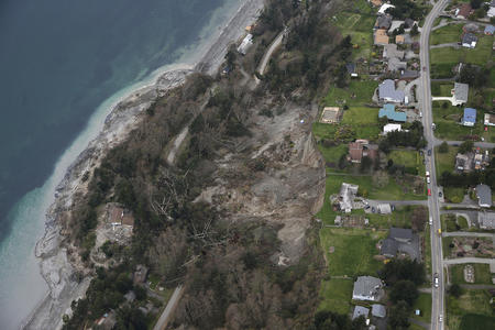 In this aerial photo, a landslide is shown near Coupeville, Wash. on Whidbey Island, Wednesday, March 27, 2013.