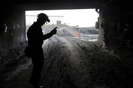 A miner at a facility in Roundup, Montana, in 2010. (Photo by Janie Osborne/AP Photo)