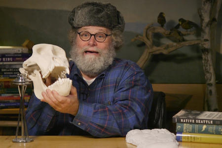 Knute Berger holds a skull