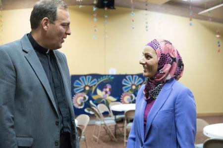 Aneelah Afzali and Rev. Terry Kyllo talk while standing in St. Paul''s Episcopal Church in Mt. Vernon.