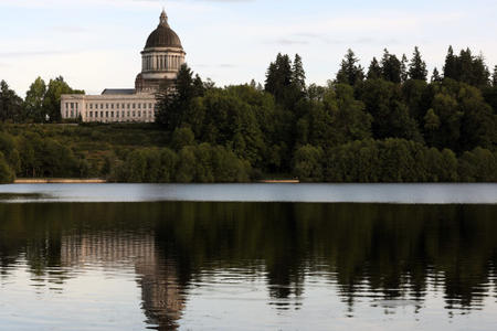 Washington's state capitol building is seen across Capitol Lake. Credit: Matt M. McKnight/Crosscut