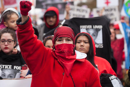 A member of the Murdered and Missing Indigenous Women's contingent leads the Seattle Women's March 2.0 in Seattle, Jan. 20, 2018.