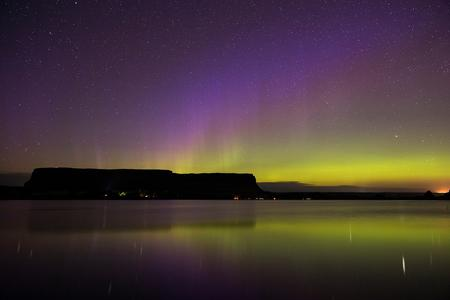 Aurora borealis is seen over Steamboat Rock at Banks Lake in eastern Washington, during the early morning hours of July 17, 2017. Knute Berger did some 'Soul-searching in plateau country'. (Matt M. McKnight/Crosscut)