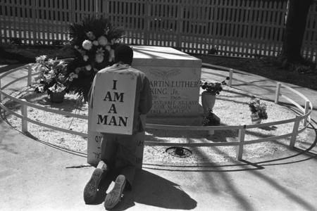 A man wearing a sign that reads I AM A MAN