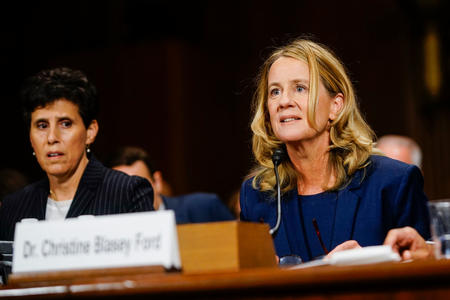 Christine Blasey Ford, with lawyer Debra S. Katz, left, answers questions at a Senate Judiciary Committee hearing on Thursday, September 27, 2018 on Capitol Hill. (Melina Mara/Pool/The Washington Post)