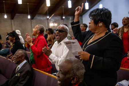 Congregation members sing