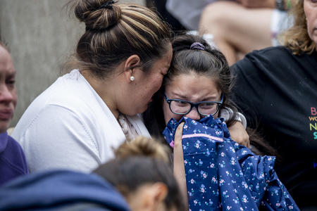 Jose Robles' wife and daughter, Natalie, 9, embrace as they learn that Robles had been detained by ICE in Tukwila on July 17, 2019.