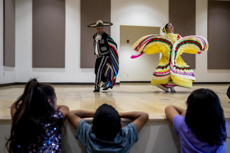 A male and female dancer perform a traditional Mexican dance