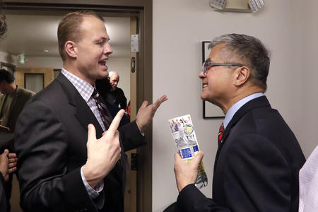 Tim Eyman speaks to Gary Locke at an October 2018 event put on by I-1000 supporters.