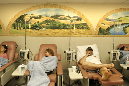 Patients sit in medical reclining chairs to receive medication