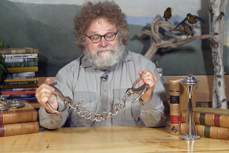 Knute holding leg irons