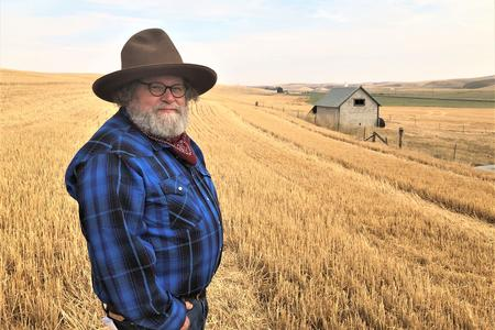 Host Knute Berger stands in a Palouse wheat field.