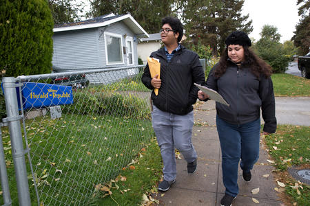 City Council candidate Eliana Macias and her brother walk on a neighborhood sidewalk while canvassing.