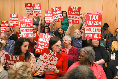 Protesters with tax amazon signs