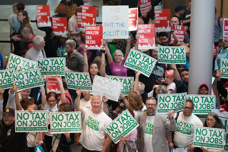 Pro- and anti-head tax activists at Seattle City Hall