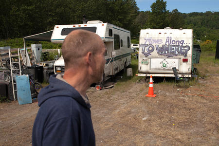 man in front of an RV