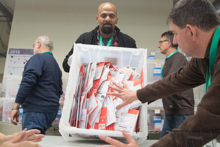 Ballots come in to King County Elections