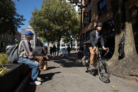 a bicyclist and a homeless man in Seattle