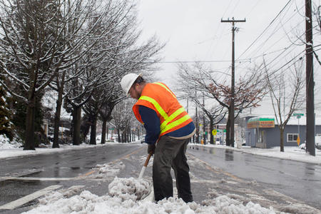 seattle DOT employee shovels snow