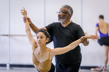 Choreographer Donald Byrd works with a dancer