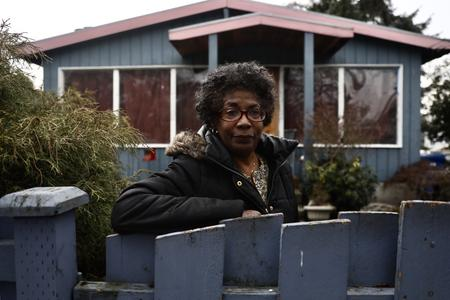 woman leans against fence in seattle