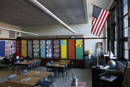 American flag hanging in a classroom