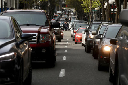 Cars sit in traffic on 5th Avenue in downtown Seattle, April 19.