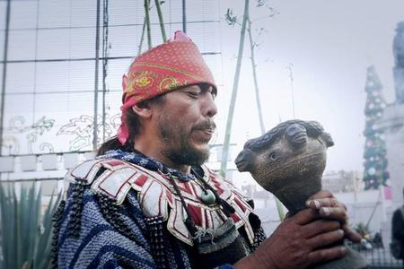 Aztec shaman blowing incense