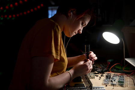 High school freshman Elly Pollock works on her robot during a Nerdy Girls meetup in Ellensburg on May 17, 2019.