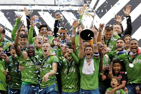 Seattle Sounders celebrate with MLS Cup trophy