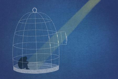 A spotlight on a bird in a cage