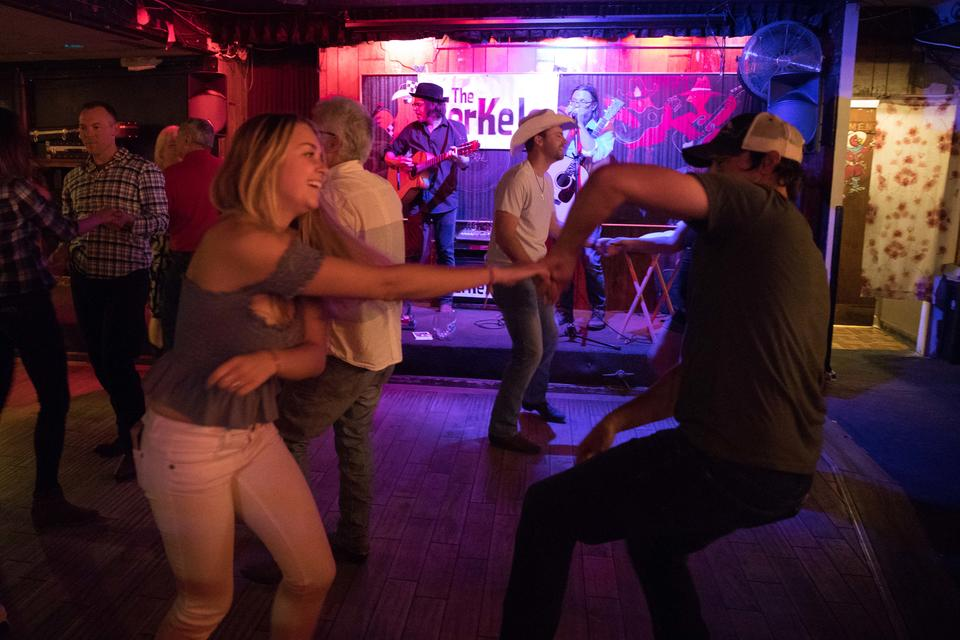 A woman dances with former bartender turned patron Jonathan Gubbe at Little Red Hen.