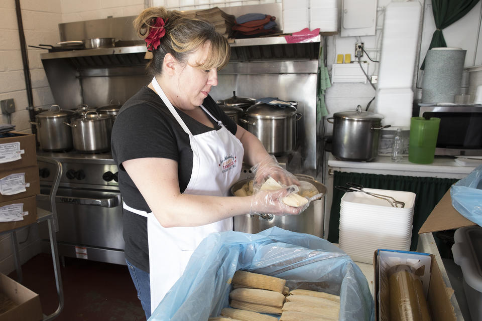 On a recent day, Rachel Wilburn, daughter of owners Felipe and June Hernández of Los Hernández Tamales, preps tamales ahead of the restaurant's opening.