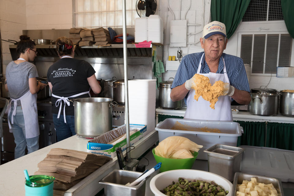 Owner Felipe Hernández prepares some of his signature tamales in the kitchen of his family restaurant in Union Gap, Washington.