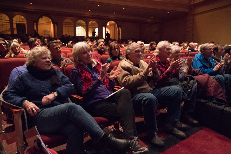 A crowd cheers during a Fisher Poet's Gathering performance at the near century-old Liberty Theatre in Astoria.