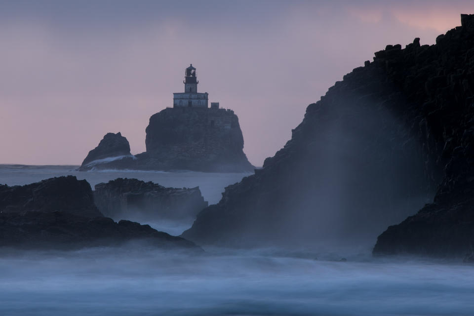 "Tillamook Rock Light, a deactivated lighthouse nicknamed ""Terrible Tilly"" on the northern Oregon coast, is seen at dusk from Indian Beach at Ecola State Park."