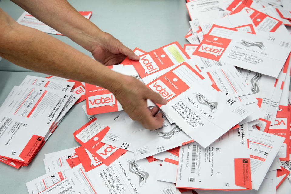 Ballot envelopes are sorted at a King County Elections office in Renton, WA