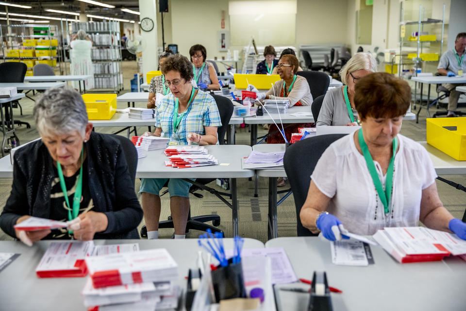 County election workers count primary ballots
