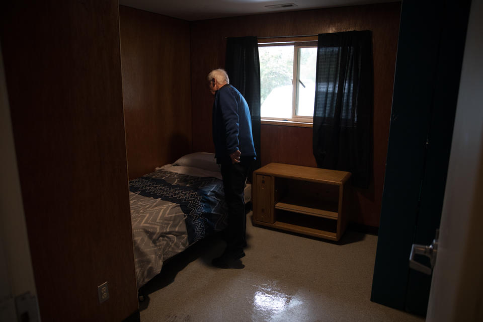 Secret Harbor President and CEO Brian Carroll tidies a bedroom inside of the organization's homes in Burlington, Washington