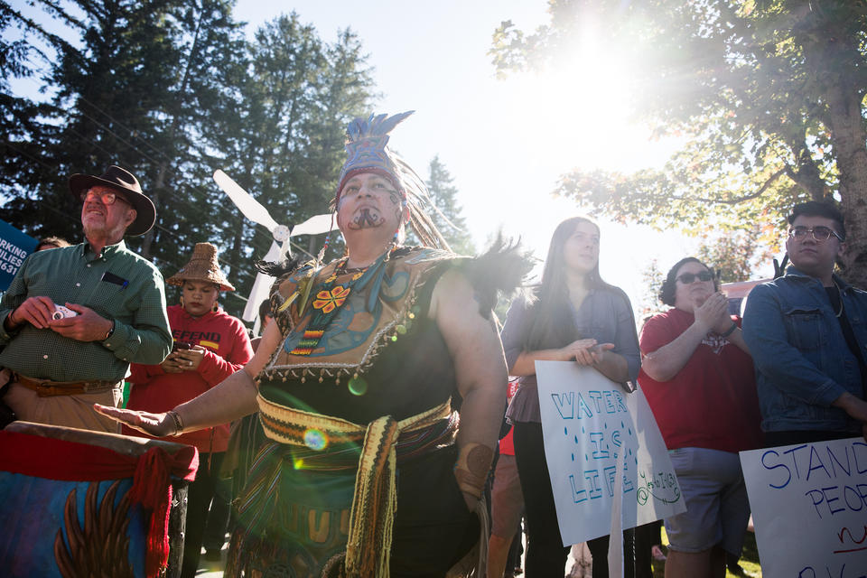 Northwest tribes in full traditional dress march in protest.
