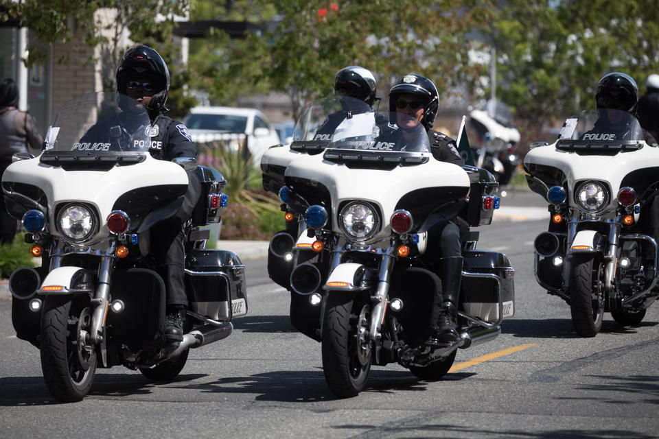 Seattle police officers riding down a street on motorcycles