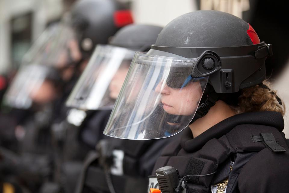 Helmeted police officers