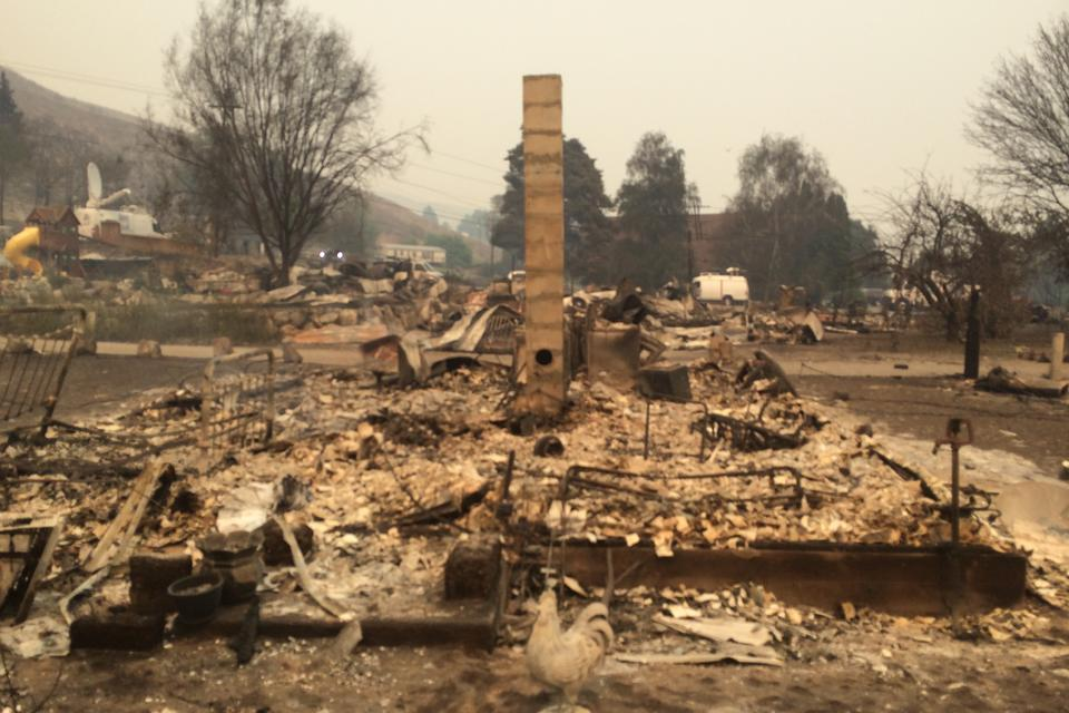 The burned remains of a neighborhood in Pateros. Only one home's chimney is still standing.